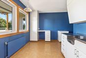 Kjøkken med eldre kjøkkeninnredning