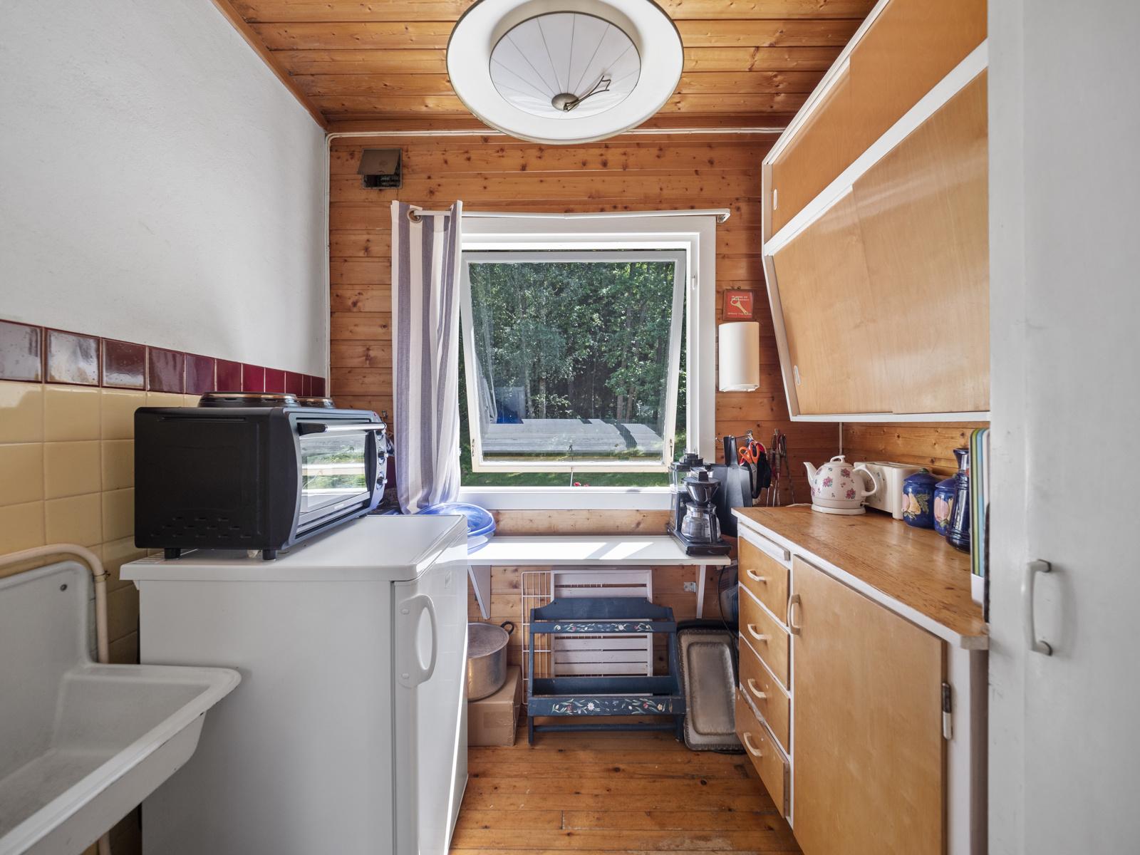 Kjøkken med eldre innredning